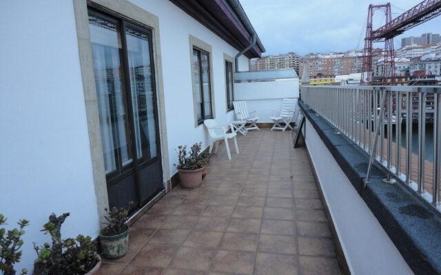 Preciosa Vivienda con Gran Terraza en una de las Mejores Zonas de Las Arenas con Bonitas Vistas a la Ría y al Puente de Bizkaia.